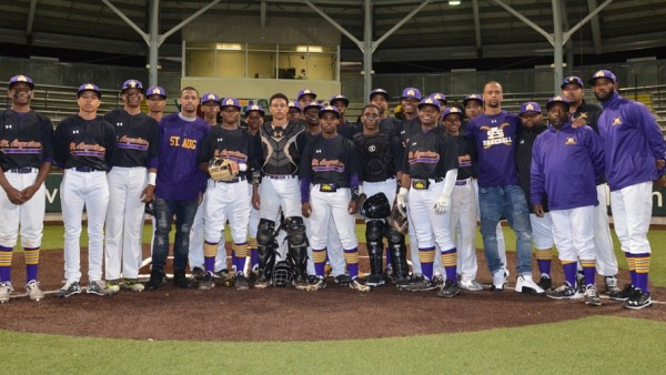 Lorenzo and Lee Doss with the Purple Knight baseball team.