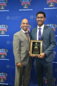 St. Augustine High School Athletic Director, Marcus Delarge with Jonathan Willard.