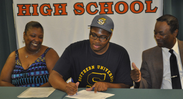 Timberland band student signs at top HBCU
