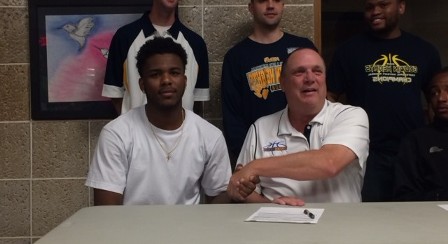 Karon Patrick signs to play basketball for Muskegon Community College