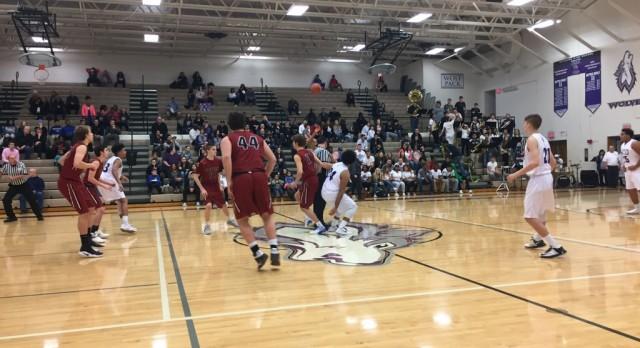 Forest Hills Eastern High School Boys Varsity Basketball falls to Wyoming High School 71-57