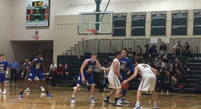 Forest Hills Eastern High School Boys Varsity Basketball falls to Grand Rapids Catholic Central High School 80-59