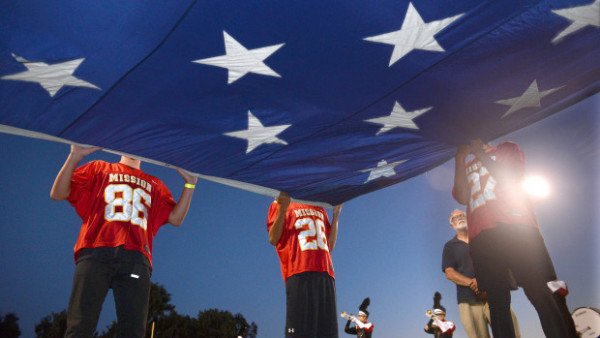 Members of the Mission Viejo junior varsity team hold the Sea to Shining Sea Flag during the national anthem on Mission For The Armed Forces night.  Mission Viejo was taking on Norco on Friday.   ///ADDITIONAL INFORMATION: hsscafetta.0919 Ð 9/18/15 Ð BILL ALKOFER, - ORANGE COUNTY REGISTER -   Mission Viejo took on Norco in a nonleague football game at Mission Viejo High School on Friday.