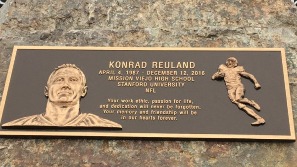 Mission Viejo High, on Friday Sept. 1, presented a plaque to the Reuland family as a way of honoring 2006 alumnus Konrad Reuland, who died in December of a brain aneurysm at 29 years old. Reuland's heart was donated to Major League Baseball Hall of Famer Rod Carew. (Courtesy of Jerry O'Brien)