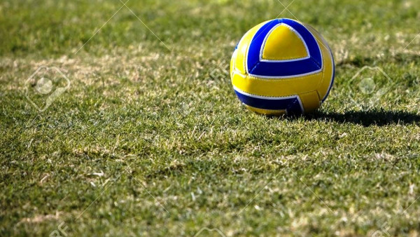 4179063-Blue-gold-soccer-ball-resting-on-the-field-Stock-Photo