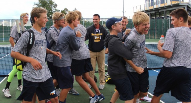 Hudsonville High School Boys Varsity Tennis beat Grand Haven High School 5-3