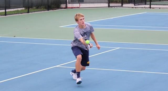 Boys Varsity Tennis 4 Singles, Isaac Bylsma, is Regional Champion!