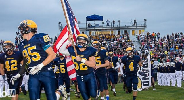 Football Honors Fallen Hero's in 43-7 Victory over Okemos