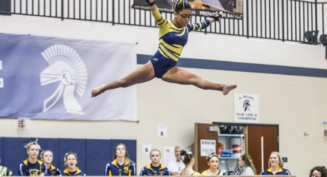 Comets Gymnastics Team Beats East Lansing and Fowlerville in CAAC Tri-Meet
