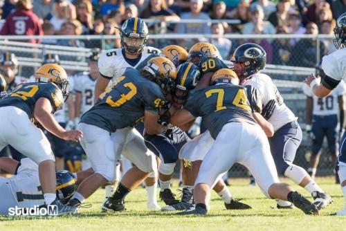 Football v DeWitt Team Tackle