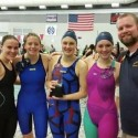 The 400 Freestyle Relay team of (L-R) Katie Thomas, Emma Cornell, Grace Weston, Lola Mull & Coach Townsend display the Pat Briggs Award given to the team each year that wins the 400 Freestyle Relay