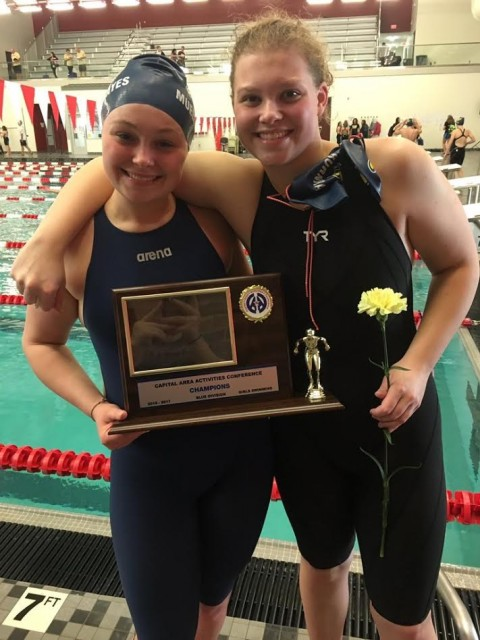 L-R Sophomore Andrea Mueller-Hayes and senior Kelsey Burnham show off the CAAC Blue Meet trophy