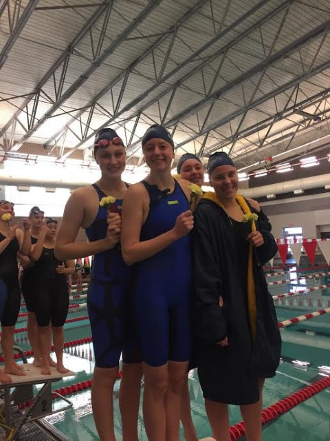 The CAAC Blue Champion & school record setting 400 Free Relay team of Grace a Weston, Emma Cornell, Lola Mull & Katie Thomas