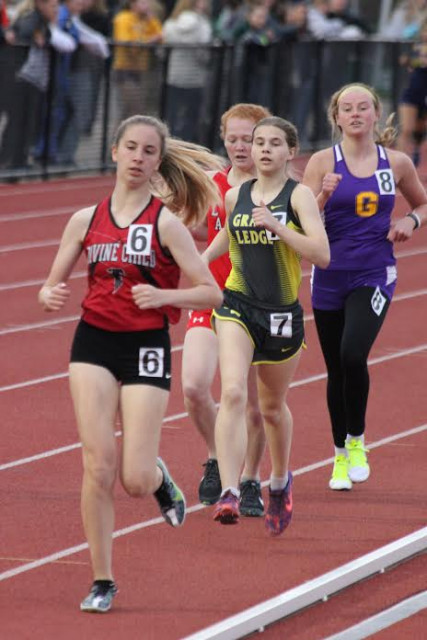 Freshman Courtney Hughes running in the 800 m run at MSU Spartan Classic.  Courtney ran a personal best in the 800 in that race.