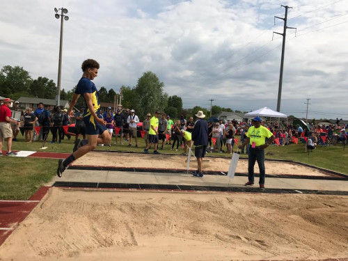 "Kavion Autrey of Grand Ledge on his way to a jump of 22'4"" which was good enough for 3rd place overall at the Division 1 State Championship held at East Kentwood HS. This earned Kavion his first all state award."