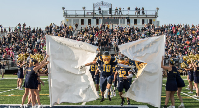 Grand Ledge Varsity Football Opens with Victory over Hudsonville before a Packed House