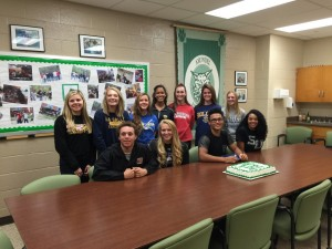 The 11 student athletes from Arundel High School signing on Nov. 11, 2015.