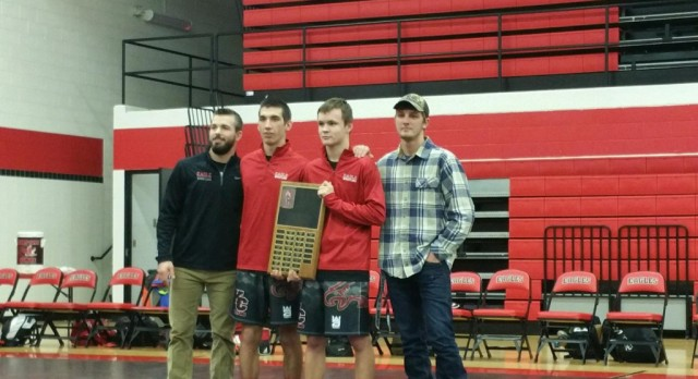 Wrestling team downs Holton and Montague; Celebrates seniors and 100 match winners