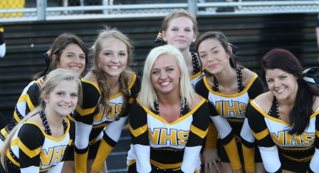 Northeast Cheerleaders Get Together For a Group Photo Under The Friday Night Lights