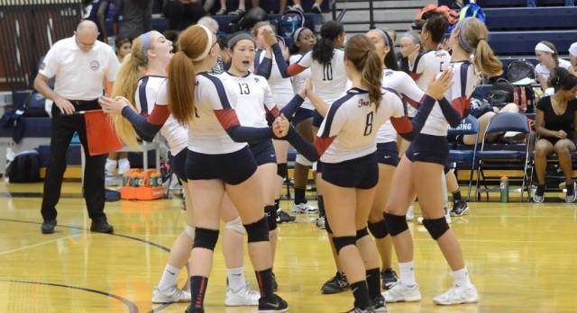 East Lansing High School Girls Varsity Volleyball beat Grand Ledge High School 3-1