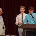 Coach Greg Christensen (left) honored by Luke Parker (middle) and Blake Pfaff (right)