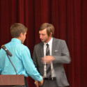 Blake Pfaff (left) honors Head Coach Logan Kelly (right)