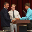 Head Coach Tim Denton (left) honored by Luke Parker (middle) and Blake Pfaff (right)