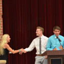 Coach Carly Littlefield (left) honored by Luke Parker (middle) and Blake Pfaff (right)