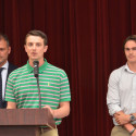 Coach Cody Alexander (middle) presents the Outstanding Relays Award to Landon McDermott (right)