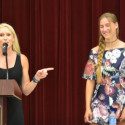 Coach Carly Littlefield (left) presents Newcomer of the Year Award to Carsen McFadden (right)