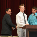 Coach Vince Hernandez (left) honored by Luke Parker (middle) and Blake Pfaff (right)