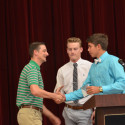 Coach Cody Alexander (left) honored by Luke Parker (middle) and Blake Pfaff (right)