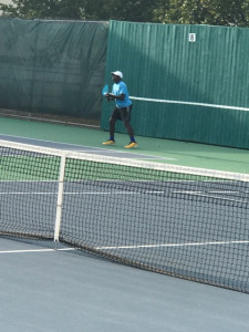 Senior Kaleb Collins ready for serve in his singles match.