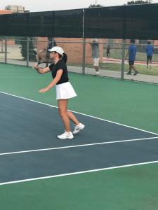 Senior Gillian Harrison battles with Arlington High.