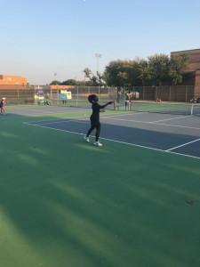 Junior Maame Effirim roared to a girls singles win vs Arlington High.