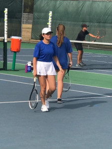 #3 doubles partner Gillian Harrison focuses on her upcoming serve.