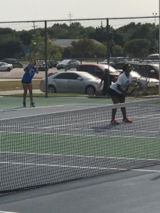 Seniors Maria Martinez and Abrian Johnson secure a win in the #2 doubles.