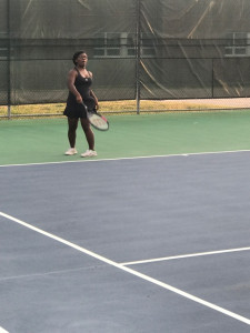 Sophmore Jayla McGill prepares for a serve from Bowie opponent.