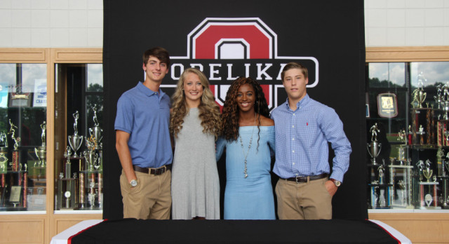 4 Dawgs sign scholarships