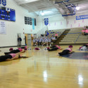 POMs Pink at Volleyball Game