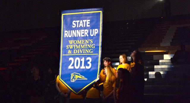 Girl's Swimming/Diving Banner raised in the gym