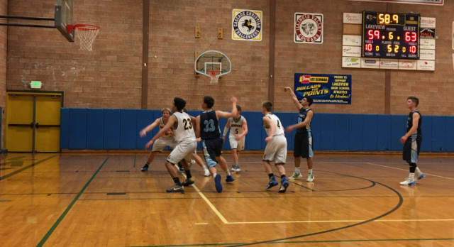 Boys Basketball Wins Key Game in Double Overtime