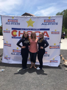 Aly, left, Coach Dori Jacobs, center, and Mackenzie, right- during the Opening Ceremonies Tailgate Party