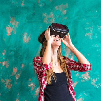 Woman in virtual reality headset enjoying her experience.