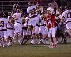 The Sea Gulls celebrate their Wednesday night 26-4 victory over Wesley College. (Photo credit: Salisbury University)