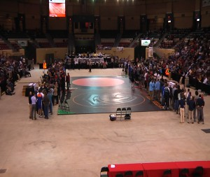 For the State Finals matches in each weight class the arena is broken down to two mats in the center. Here the finalist line up with their parents for announcements and introductions before the finals commence.