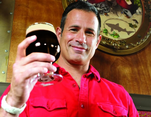 Dogfish Head Brewery founder, Sam Calagione, raises his glass (Photo Courtesy: Dogfish Head Brewery)