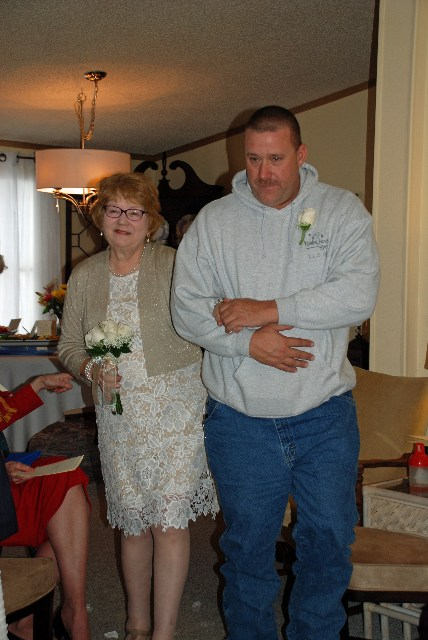 Stephen Hackett, escorted his mother from the dining room into the  living room. He was dressed in jeans and hoodie sweatshirt, formalized  with a boutonniere.