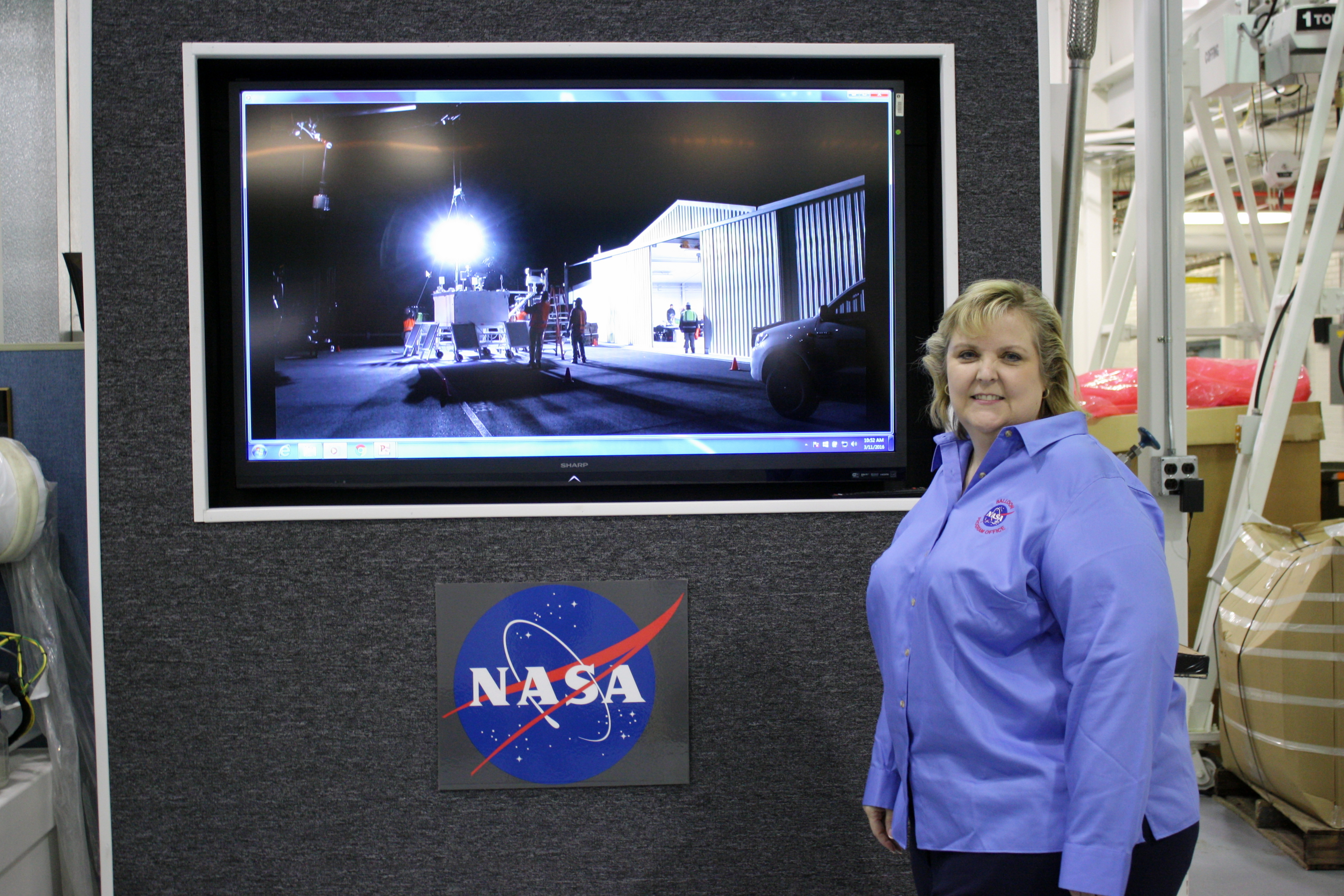 Debbie Fairbrother poses next to her PowerPoint presentation for the upcoming launch.