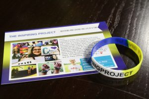 "Chase's bracelet and ""Inspiring Project"" flyer"